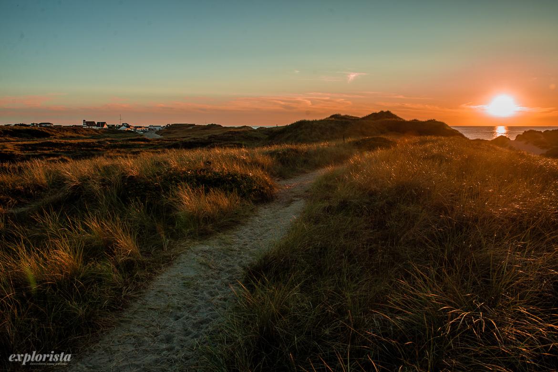 solnedgång över sanddynor