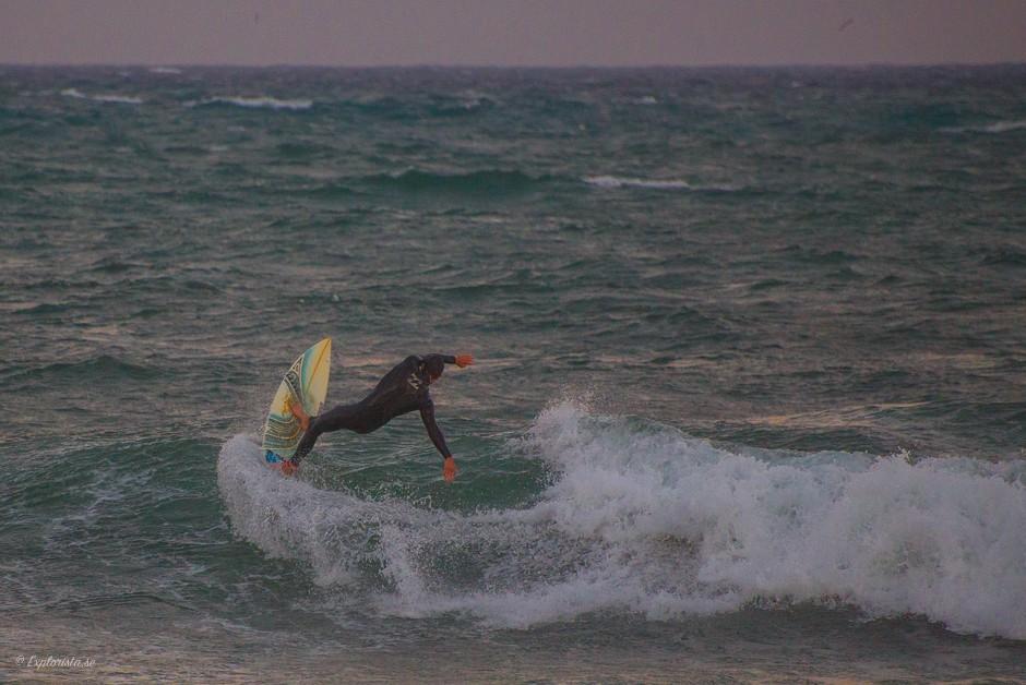surfare våg