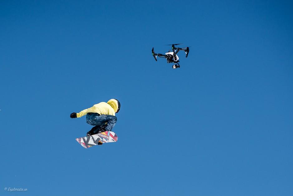 girl snowboard jump drone